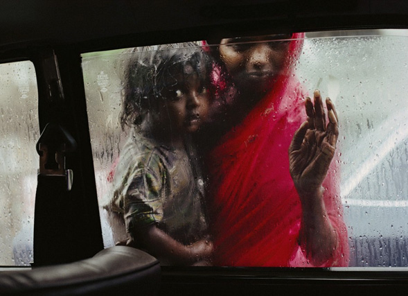 Vrouw met kind in India - Steve McCurry